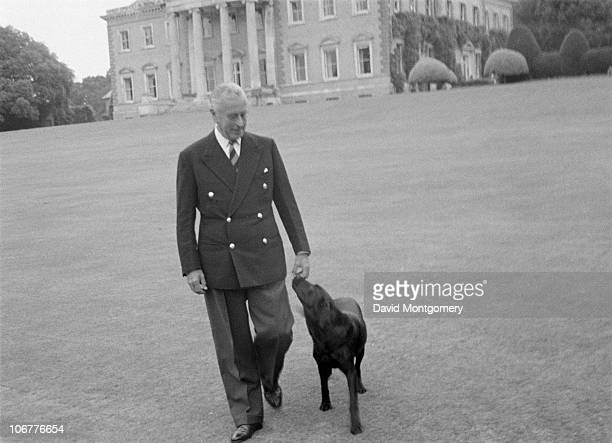 Louis Mountbatten 1st Earl Mountbatten of Burma with his dog outside his home Broadlands near Romsey Hampshire circa 1968