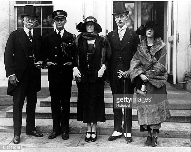 Louis Mountbatten the 1st Earl Mountbatten of Burma poses for a group portrait with two other men and two women