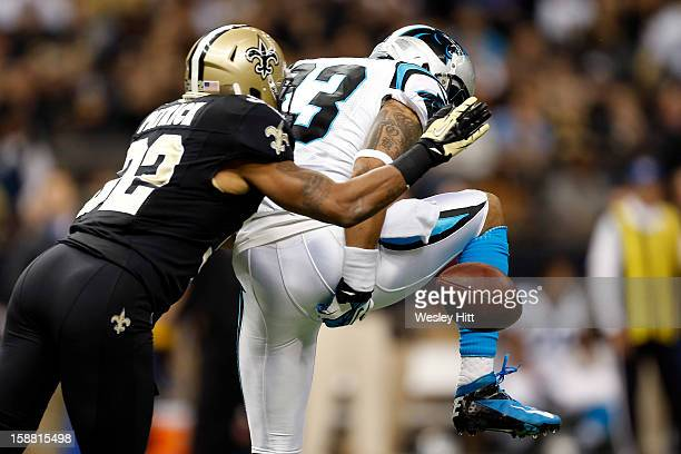 Louis Murphy of the Carolina Panthers drops a pass while covered by Johnny Patrick of the New Orleans Saints at MercedesBenz Superdome on December 30...