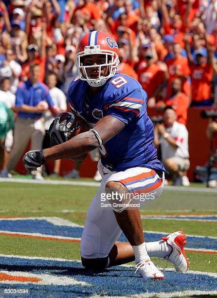 Louis Murphy of the Florida Gators looks toward the crowd after scoring a touchdown against the Ole Miss Rebels at Ben Hill Griffin Stadium on...