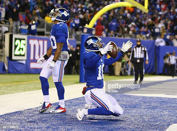Louis Murphy of the New York Giants celebrates a touchdown against the Dallas Cowboys during their game at MetLife Stadium on November 24 2013 in...