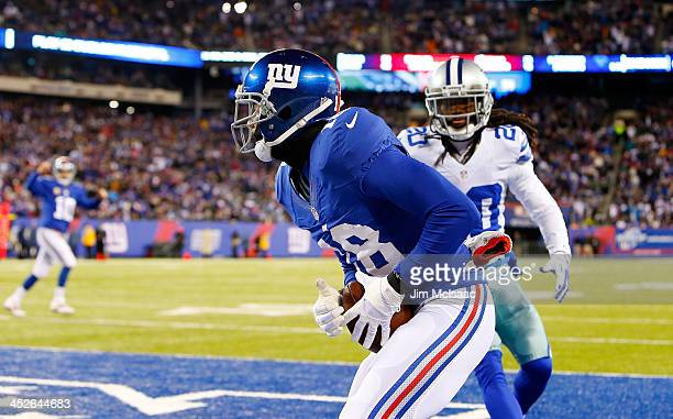 Louis Murphy of the New York Giants hauls in a touchdown pass against BW Webb of the Dallas Cowboys on November 24 2013 at MetLife Stadium in East...