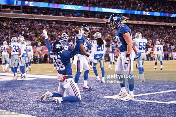 Louis Murphy of the New York Giants shows emotion after scoring a touchdown during the game against the Dallas Cowboys at MetLife Stadium on November...