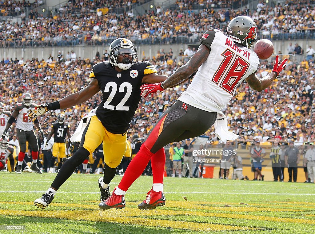 Louis Murphy #18 of the Tampa Bay Buccaneers can't make a catch in front of William Gay #22 of the Pittsburgh Steelers during the fourth quarter at Heinz Field on September 28, 2014 in Pittsburgh, Pennsylvania.