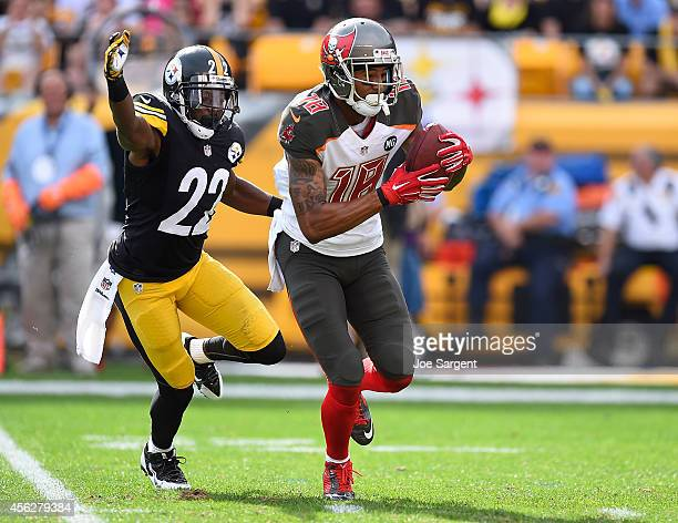 Louis Murphy of the Tampa Bay Buccaneers carries the ball in front of William Gay of the Pittsburgh Steelers during the fourth quarter at Heinz Field...