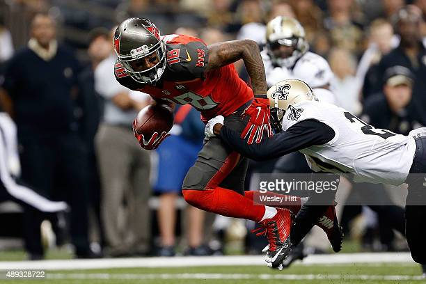 Louis Murphy of the Tampa Bay Buccaneers is brought down by Damian Swann of the New Orleans Saints during the second quarter of a game at the...