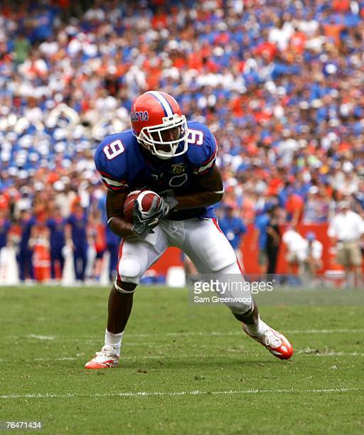 Louis Murphy#9 of the Florida Gators catches a pass against the Western Kentucky Hilltoppers on September 1 2007 at Ben Hill Griffin Stadium in...