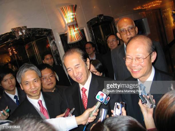 Louis Ng Chising Director of Sociedade De Jogos De Macau SA Stanley Ho Hungsun and Ambrose So speaks in Macau after attending a shareholdersÈ meeting...
