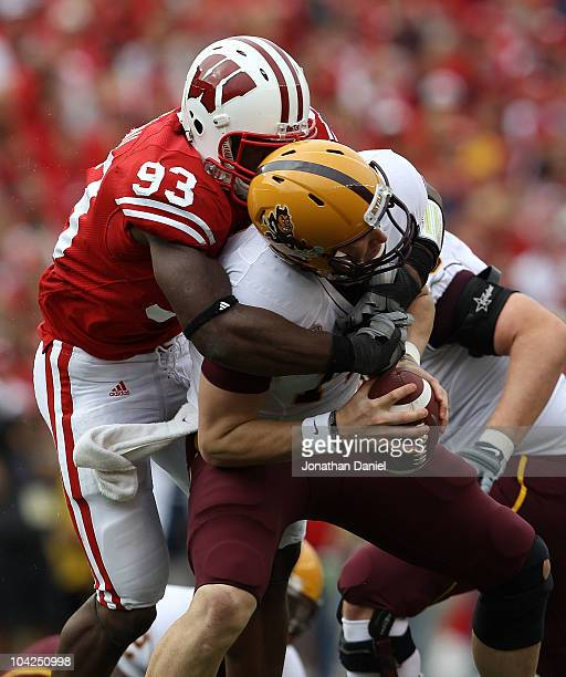 Louis Nzegwu of the Wisconsin Badgers sacks Steven Threet of the Arizona State Sun Devils at Camp Randall Stadium on September 18 2010 in Madison...