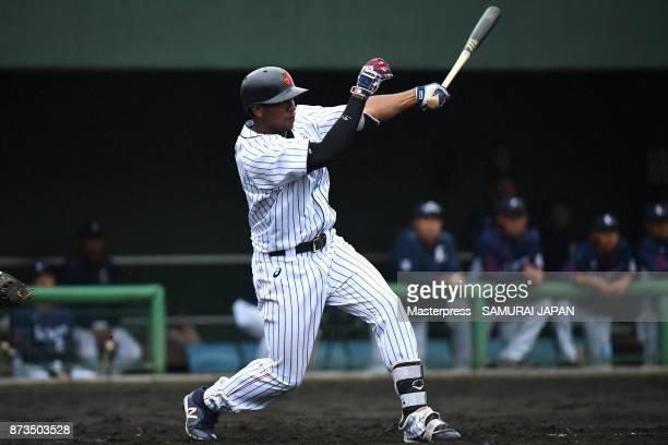 Louis Okoye of Samurai Japan hits a single during a practice game between Japan and Saitama Seibu Lions at Sokken Stadium on November 13, 2017 in...