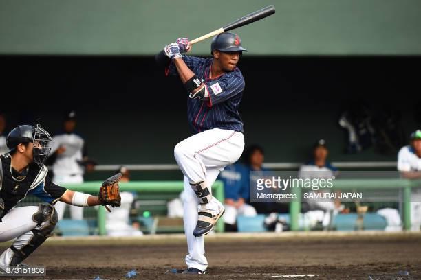 Louis Okoye of Samurai Japan swings at a pitch during the practice game between Japan and Hokkaido Nippon Ham Fighters at Sokken Stadium on November...