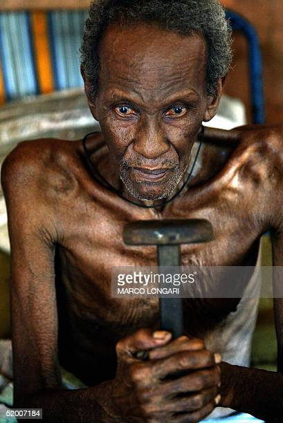 Louis Onesime sits in the house he shares with 26 other family members in Port Louis Mauritius 17 January 2005 Louis originally from Diego Garcia...