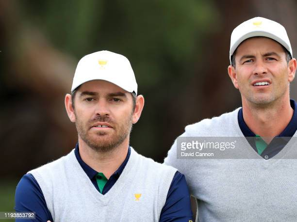 Louis Oosthuizen and Adam Scott of the International Team watch a big screen during the afternoon fourball matches in the 2019 Presidents Cup at...