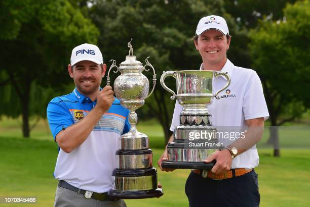 Louis Oosthuizen of South Africa and amateur Jovan Rebula of South Africa pose with trophies after the final round on day four of the South African...