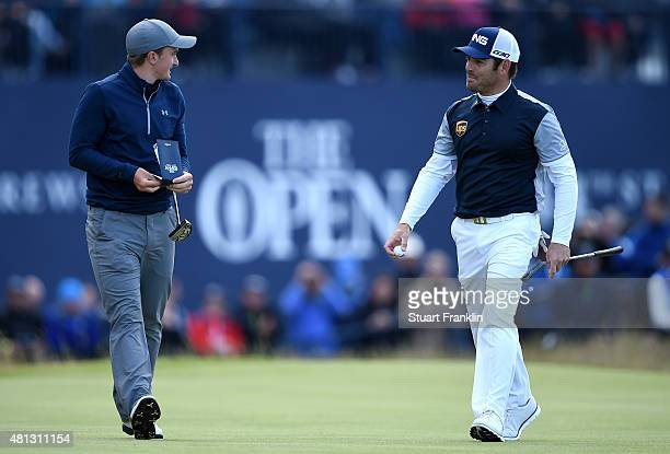 Louis Oosthuizen of South Africa and amateur Paul Dunne of Ireland in discussion on the 18th green during the third round of the 144th Open...