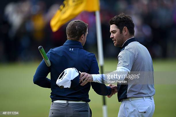 Louis Oosthuizen of South Africa and amateur Paul Dunne of Ireland shake hands on the 18th green during the third round of the 144th Open...
