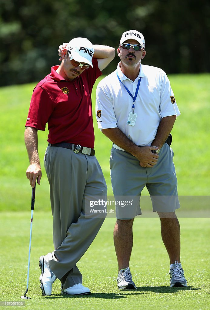 Louis Oosthuizen of South Africa and his caddie Wynand Stander sport moustaches during the Pro-Am of the Nedbank Golf Challenge at the Gary Player Country Club on November 28, 2012 in Sun City, South Africa.