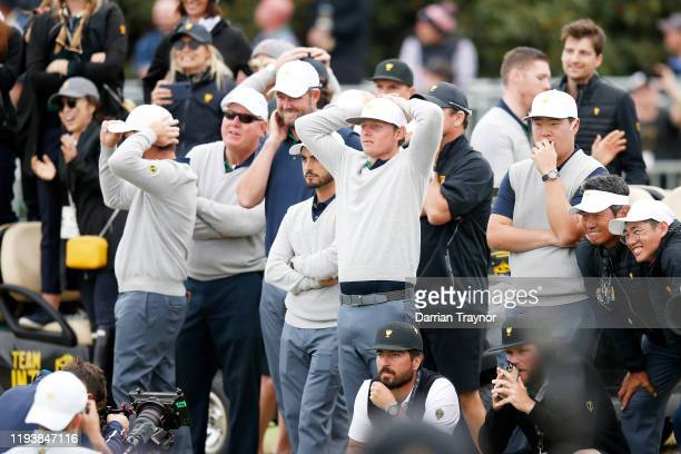 Louis Oosthuizen of South Africa and the International team, Marc Leishman of Australia and the International team, Abraham Ancer of Mexico and the...
