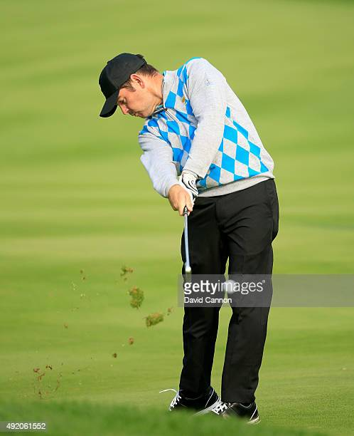 Louis Oosthuizen of South Africa and the International Team plays his second shot on the sixth hole in his match with Branden Grace against Patrick...