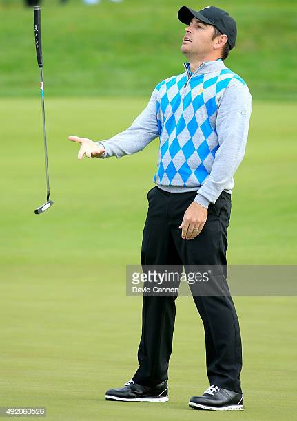 Louis Oosthuizen of South Africa and the International Team reacts as his putt for par misses on the sixth hole in his match with Branden Grace...
