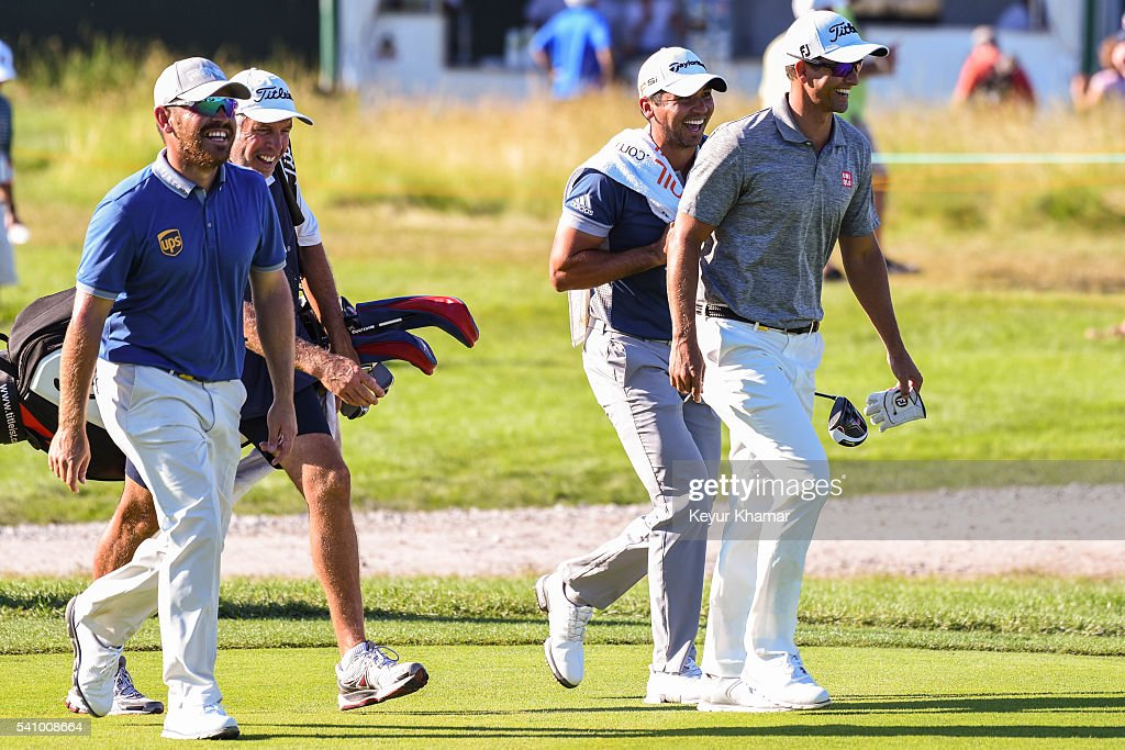 Louis Oosthuizen of South Africa, caddie Steve Williams, Jason Day of Australia and Adam Scott of Australia share a laugh as they walk up the 17th hole fairway during the second round of the U.S. Open at Oakmont Country Club on June 17, 2016 in Oakmont, Pennsylvania.