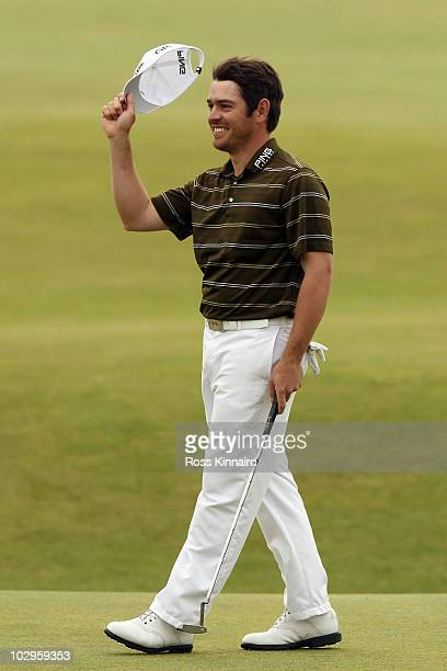 Louis Oosthuizen of South Africa celebrates his sevenstroke victory in the final round of the 139th Open Championship on the Old Course St Andrews on...