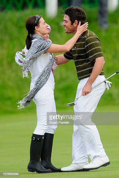 Louis Oosthuizen of South Africa celebrates his sevenstroke victory with his wife NelMare and daughter Jana at the 139th Open Championship on the Old...