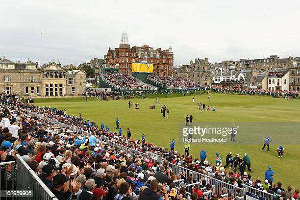 Louis Oosthuizen of South Africa celebrates his sevenstroke victory on the 18th green in the final round of the 139th Open Championship on the Old...