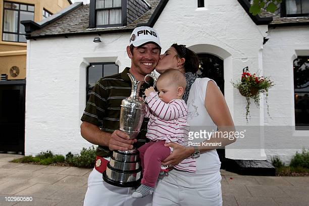 Louis Oosthuizen of South Africa celebrates his sevenstroke victory with his wife NelMare and daughter Jana outside the Jigger Inn after the 139th...