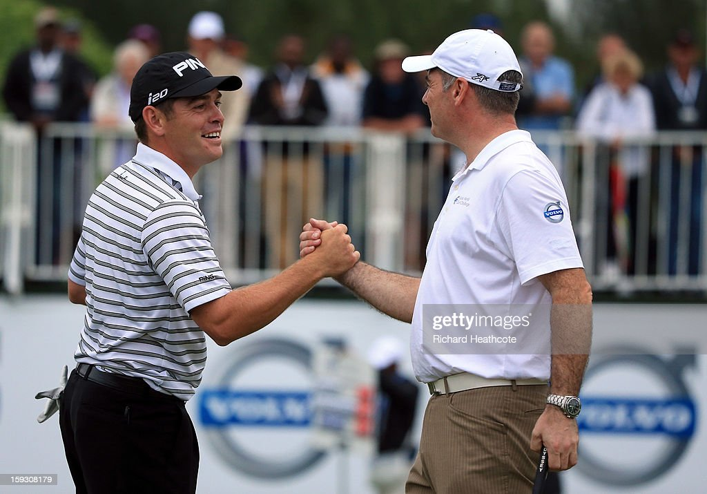 Louis Oosthuizen of South Africa celebrates with amateur partner Colin Ledworth of England as Colin holes a birdie putt on the 18th green to help his team win the pro-am competition during the second round of the Volvo Champions at Durban Country Club on January 11, 2013 in Durban, South Africa.