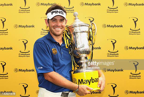 Louis Oosthuizen of South Africa celebrates with the trophy after winning thefinal round of the Maybank Malaysian Open at Kuala Lumpur Golf Country...