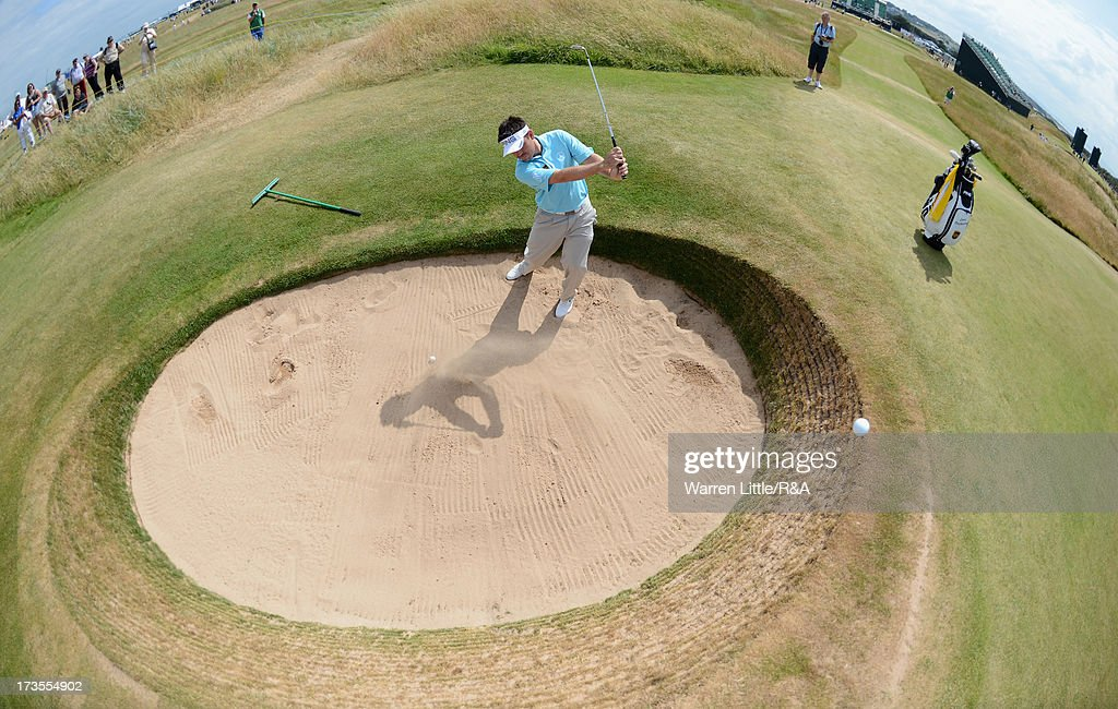 Louis Oosthuizen of South Africa hits from a bunker on the 13th hole ahead of the 142nd Open Championship at Muirfield on July 16, 2013 in Gullane, Scotland.