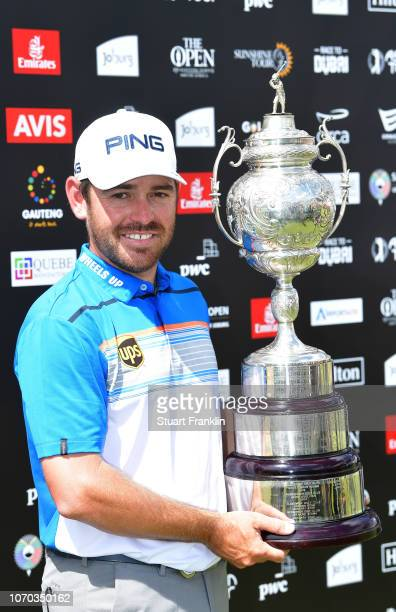 Louis Oosthuizen of South Africa holds the trophy after winning the South African Open at Randpark Golf Club on December 9, 2018 in Johannesburg,...