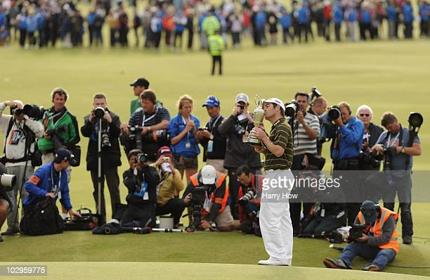 Louis Oosthuizen of South Africa is photographed as he kisses the Claret Jug after his sevenstroke victory at the 139th Open Championship on the Old...