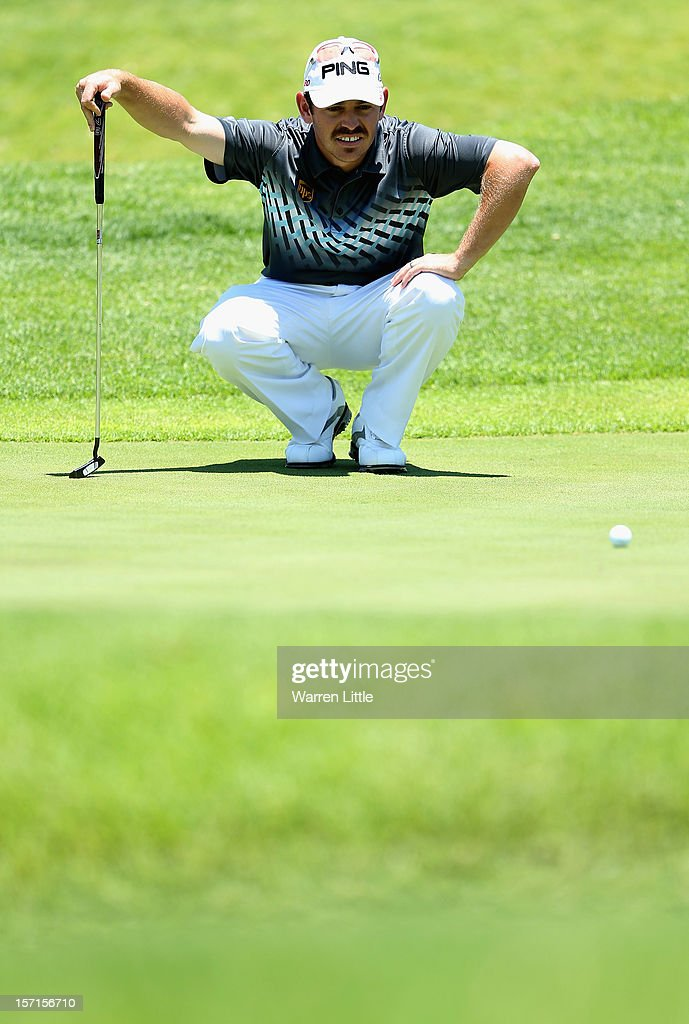 Louis Oosthuizen of South Africa lines up a putt during the first round of the Nedbank Golf Challenge at the Gary Player Country Club on November 29, 2012 in Sun City, South Africa.