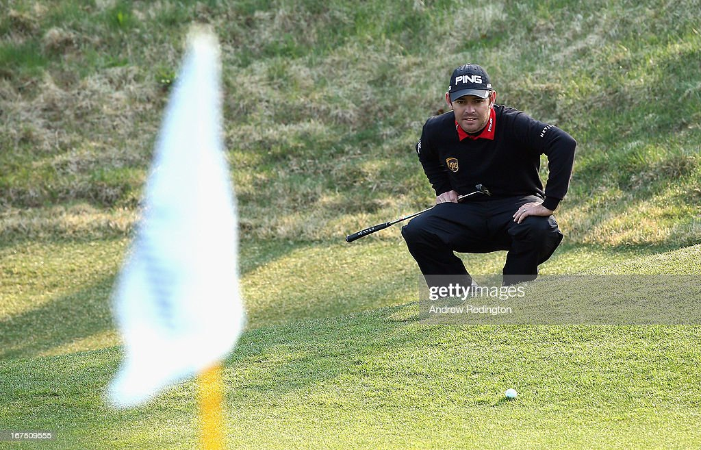 Louis Oosthuizen of South Africa lines up a putt on the 18th hole during the completion of the first round of the Ballantine's Championship at Blackstone Golf Club on April 26, 2013 in Icheon, South Korea.