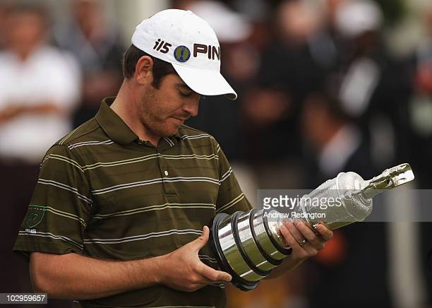 Louis Oosthuizen of South Africa looks at the winners names on the Claret Jug after his sevenstroke victory at the 139th Open Championship on the Old...