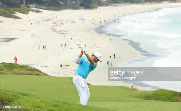 Louis Oosthuizen of South Africa plays a second shot on the ninth hole during the first round of the 2019 US Open at Pebble Beach Golf Links on June...