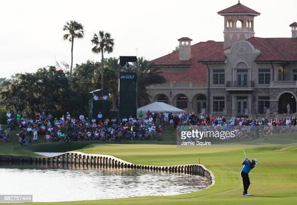 Louis Oosthuizen of South Africa plays a shot on the 18th hole during the third round of THE PLAYERS Championship at the Stadium course at TPC...