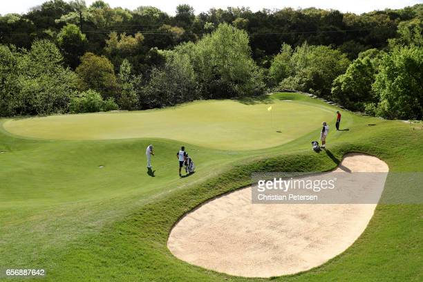 Louis Oosthuizen of South Africa plays a shot on the 2nd hole of his match during round two of the World Golf ChampionshipsDell Technologies Match...