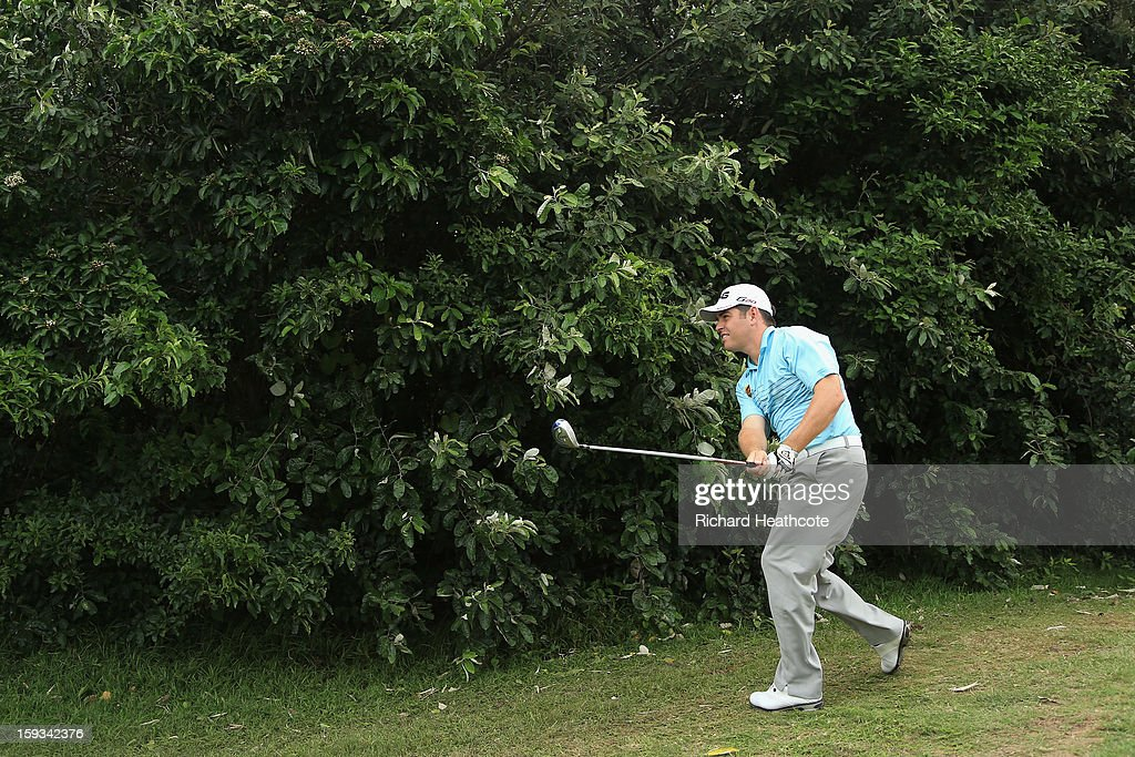 Louis Oosthuizen of South Africa plays around a bush after taking a drop on the 8th hole during the third round of the Volvo Champions at Durban Country Club on January 12, 2013 in Durban, South Africa.