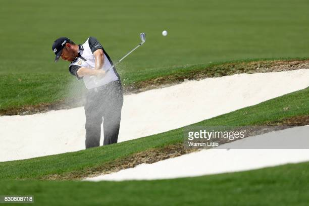 Louis Oosthuizen of South Africa plays his second shot from a bunker on the fifth hole during the third round of the 2017 PGA Championship at Quail...