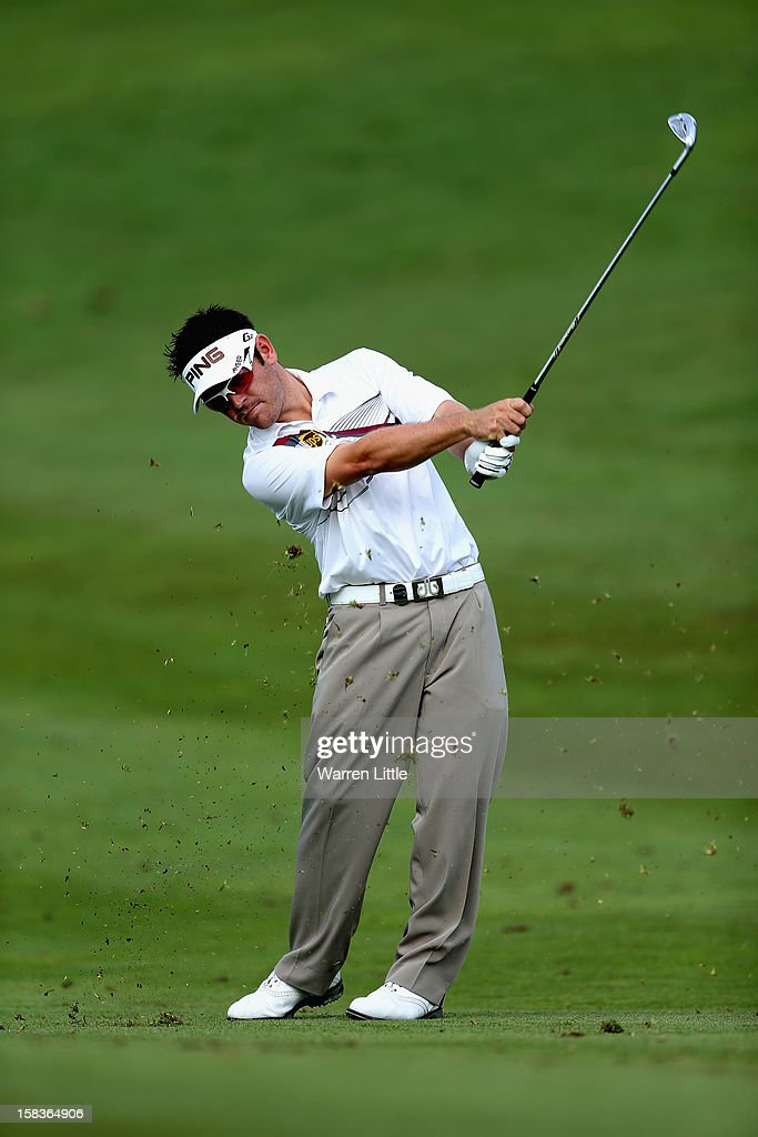 Louis Oosthuizen of South Africa plays his second shot into the 14th green during the second round of the Alfred Dunhill Championship at Leopard Creek Country Golf Club on December 14, 2012 in Malelane, South Africa.