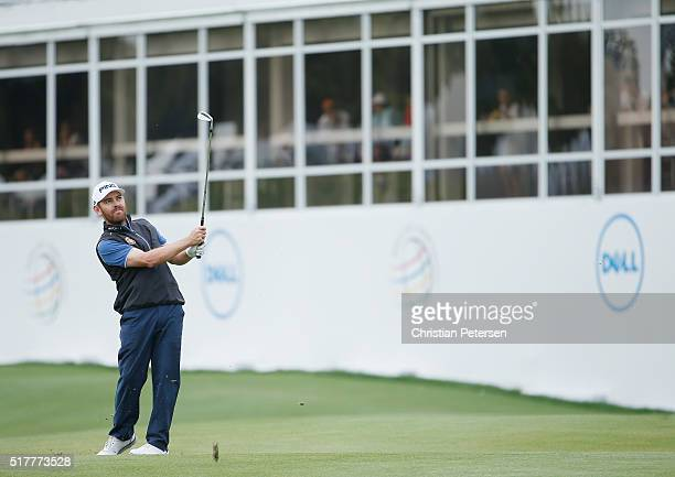 Louis Oosthuizen of South Africa plays his second shot on the 12th hole during his semifinal match with Rafa CabreraBello at the World Golf...