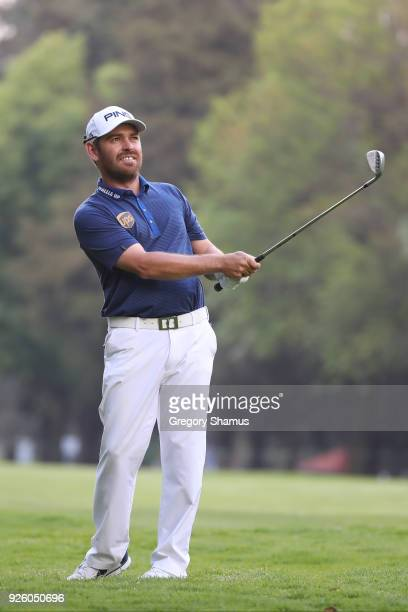 Louis Oosthuizen of South Africa plays his second shot on the 18th hole during the first round of World Golf ChampionshipsMexico Championship at Club...
