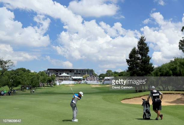 Louis Oosthuizen of South Africa plays his second shot on the par 4, 18th hole during the final round of the South African Open on the Firethorn...