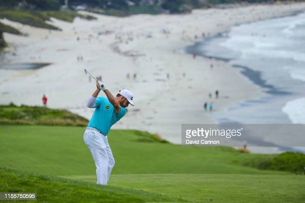 Louis Oosthuizen of South Africa plays his second shot on the par 4 ninth hole during the first round of the 2019 USOpen at the Pebble Beach Golf...