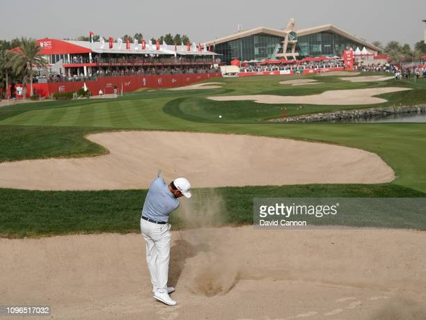 Louis Oosthuizen of South Africa plays his second shot on the par 5 18th hole during the final round of the Abu Dhabi HSBC Golf Championship at the...