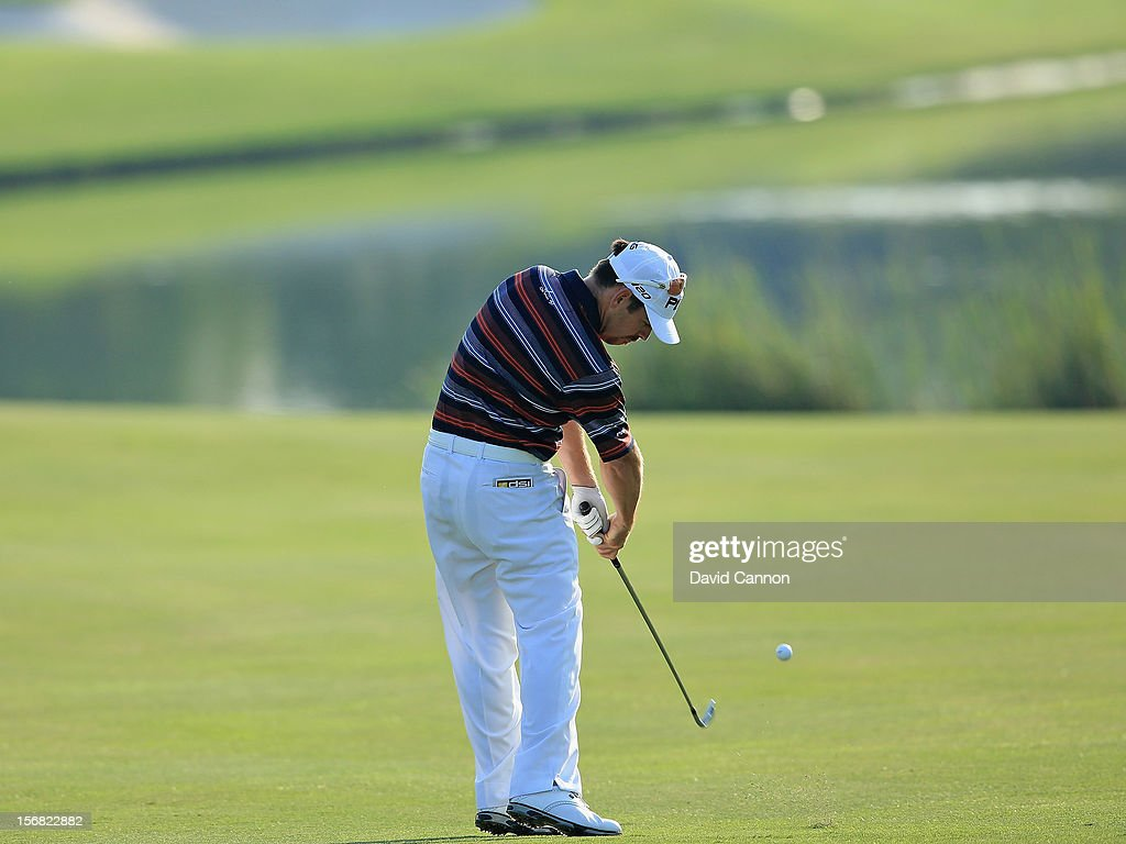 Louis Oosthuizen of South Africa plays his second shot on the par five 14th hole during the first round of the 2012 DP World Tour Championship on the Earth Course at Jumeirah Golf Estates on November 22, 2012 in Dubai, United Arab Emirates.