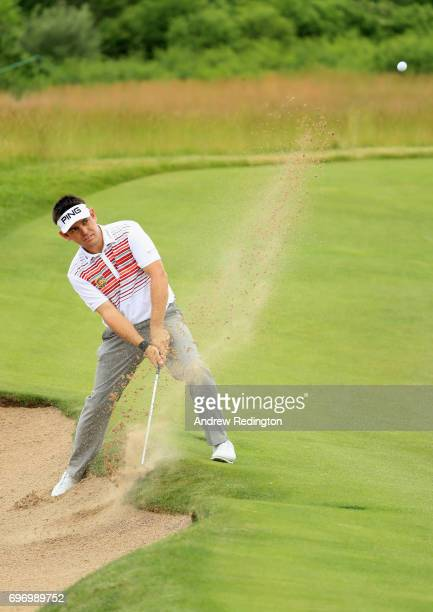 Louis Oosthuizen of South Africa plays his shot from a bunker on the 16th hole during the third round of the 2017 US Open at Erin Hills on June 17...
